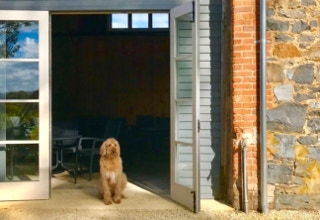 Basil waiting to usher in patrons to the Waterton Hall Barn