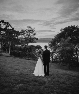 Waterton Hall Wines - bride & groome overlooking the estate and Tamar River